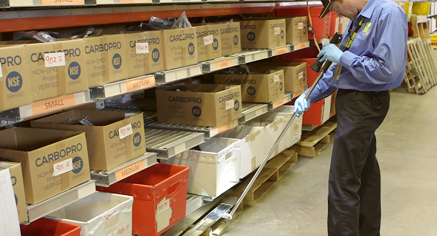 Pest professional inspecting office warehouse